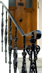 Metal stairrailing painted with Hammerite Direct to Rust Smooth black